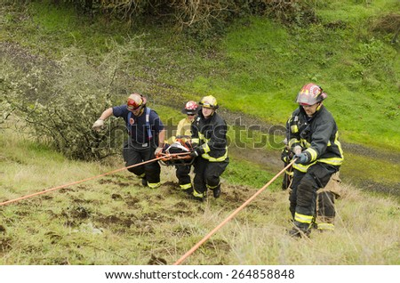 Roseburg, OR, USA - December 5, 2014: Douglas County Fire District #2 conducting a low angle rope rescue of a car crash victim - stock photo