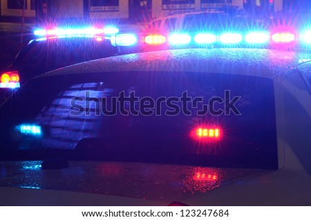 ROSEBURG OREGON  - DECEMBER 17: Police cars at incident where a person who shot at officers and then barricaded himself in a hotel in Roseburg Oregon, December 17, 2012 - stock photo