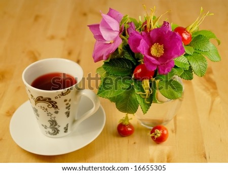 "Rosehip tea, rosehips and ""rosa rugosa"" - stock photo"
