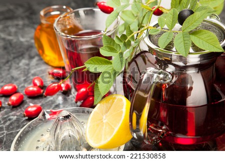 rosehip tea with honey and lemon in glass - stock photo