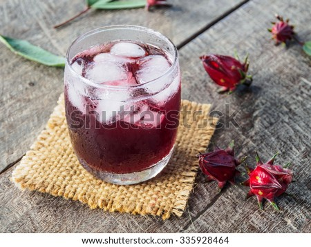 Roselle drink on wooden table - stock photo