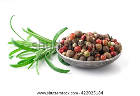 rosemary and pepper on white background
