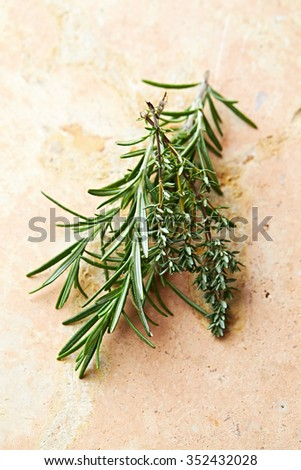 Rosemary and thyme on a stone background - stock photo