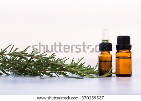 Rosemary aromatherapy essential oils in bottles
