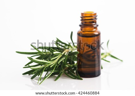 Rosemary essential oil - stock photo