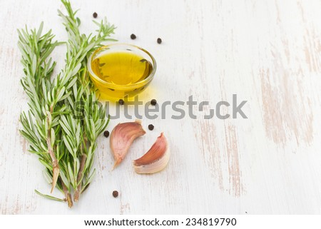 rosemary with oil and garlic, close up - stock photo