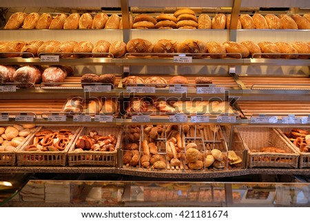 ROSENBERG, GERMANY - JUNE 08: Modern bakery with different kinds of bread, cakes and buns in Rosenberg, Germany on June 08, 2015. - stock photo