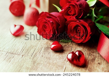 Roses and a hearts on wooden board, Valentines Day background, wedding day