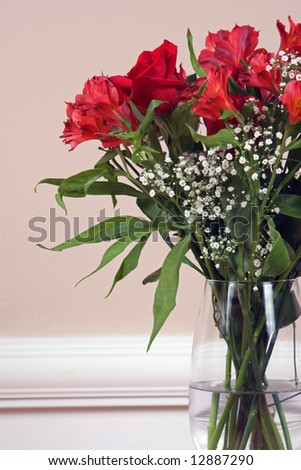 Roses and Alstroemeria in a crystal vase. - stock photo