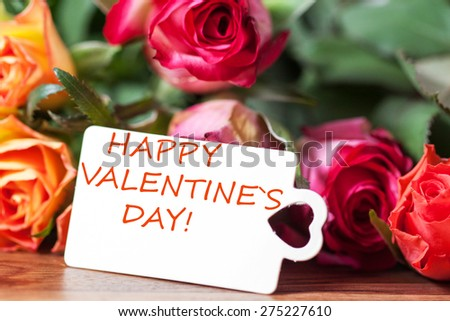 roses and card with lettering happy valentines day - stock photo