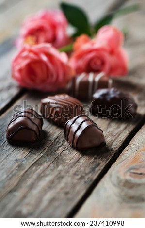 roses and chocolate candies for Valentine's Day  - stock photo