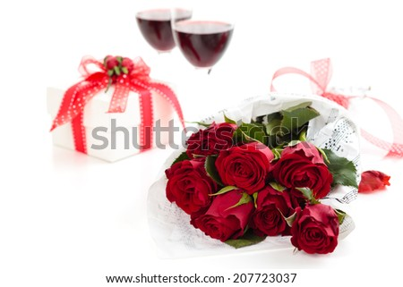 Roses and gift. Isolated on white background.