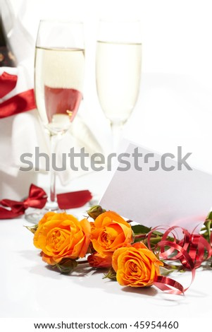 Roses and glasses of champagne