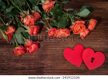 Roses and hearts shape with copy space on wooden background. Valentines day background. Love - stock photo
