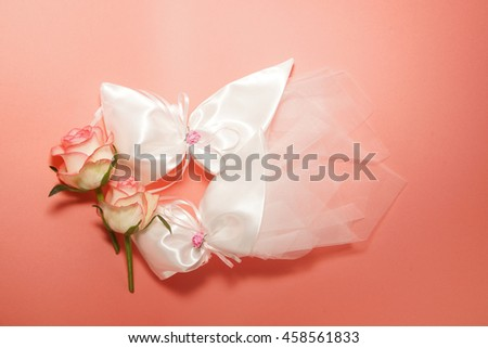 roses and tulle on pink background