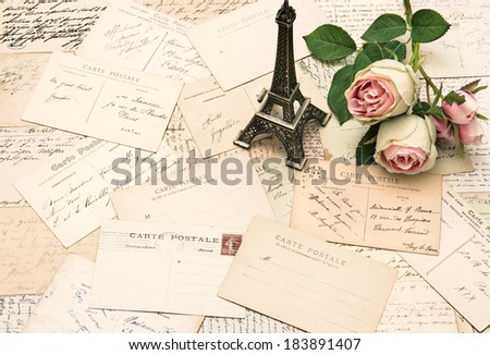 roses, antique french postcards and souvenir Eiffel Tower from Paris. nostalgic sentimental background