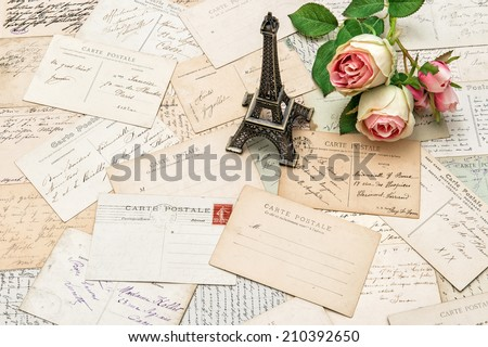roses, antique french postcards carte postale and souvenir Eiffel Tower from Paris. nostalgic sentimental holidays background
