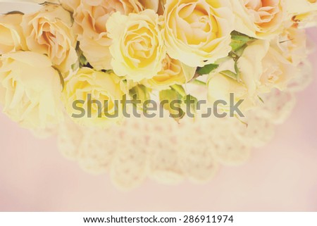 roses background on the crochet doily