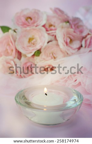 roses background with tulle and candle