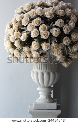 Roses bouquet at marble pole - stock photo