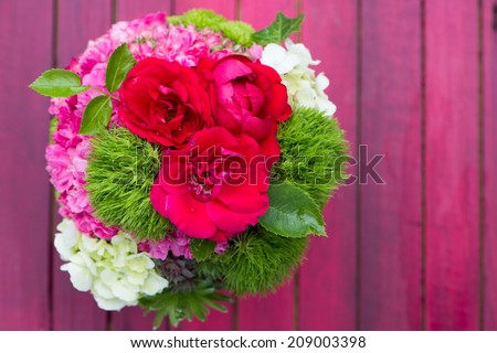 Roses bouquet on wooden background - stock photo