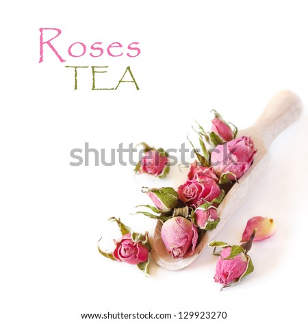 Roses flowers tea in a wooden scoop on a white background. - stock photo