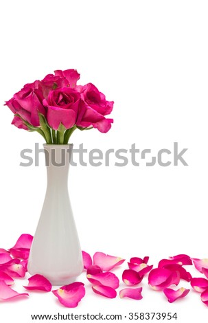 Roses in a jar and rose petals - stock photo