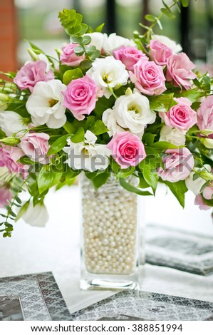 roses in a vase of delicate shades, pink and white roses, delicate bouquet, the decoration of the solemn event, - stock photo