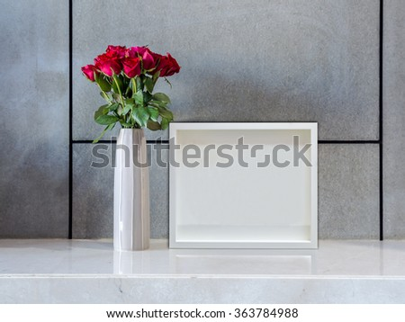 Roses in flower vase over modern wall background/ home decoration & improvement concept - stock photo