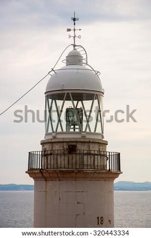 Roses lighthouse in Costa Brava Girona Spain - stock photo