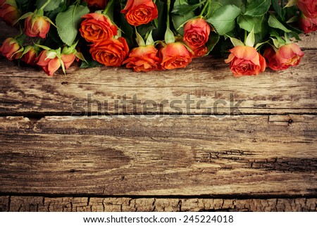 Roses on wooden board, Valentines Day background, wedding day - stock photo