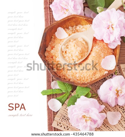 Roses spa (fresh roses flowers,spa salt, zen stones) on a wooden bord (with easy removable text) - stock photo
