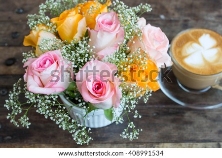 Roses  with coffee  background on wooden desk , soft focus