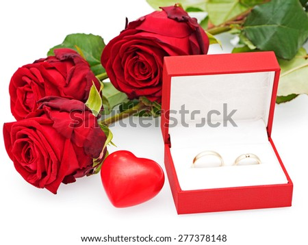 Roses with hearts and two wedding rings - stock photo