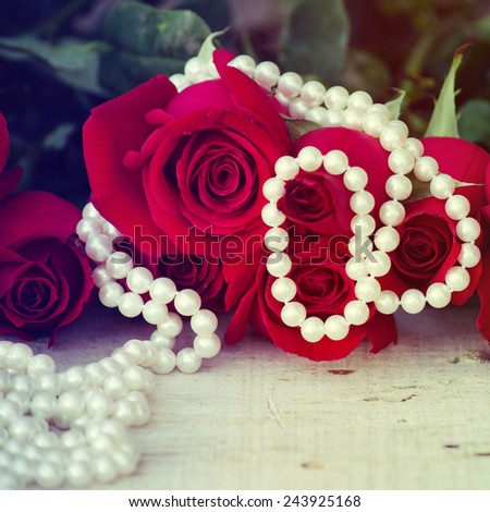 Roses with pearls  - stock photo