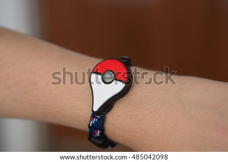 Roseville, CA - September 18: A Pokemon Go player wears the new Pokemon Go Plus on their wrist. Pokemon Go is a free-to-play augmented reality game developed by Niantic for iOS and Android devices.