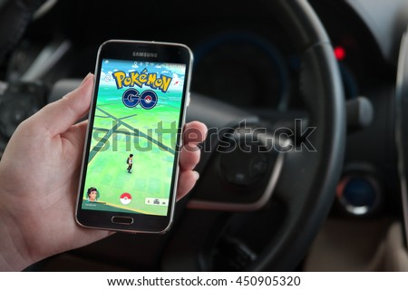 Roseville, CA/USA - July 11, 2016: An Android user plays Pokemon Go in a car, a free-to-play augmented reality mobile game developed by Niantic for iOS and Android devices.