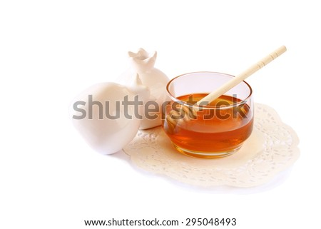 rosh hashanah (jewesh holiday) concept - honey and pomegranate isolated on white. traditional holiday symbols.