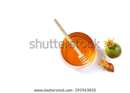 rosh hashanah (jewesh holiday) concept - honey and pomegranate isolated on white. traditional holiday symbols.  - stock photo