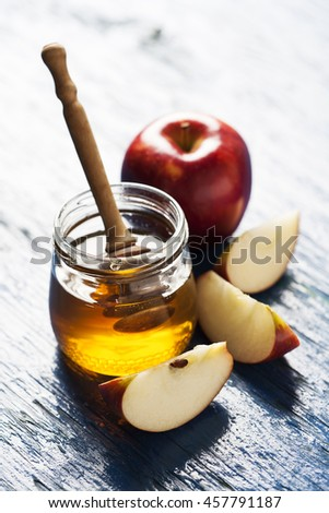 Rosh hashanah (jewesh holiday) concept: honey, apple and pomegranate