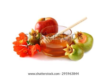 rosh hashanah (jewesh holiday) concept - honey, apple and pomegranate isolated on white. traditional holiday symbols.  - stock photo