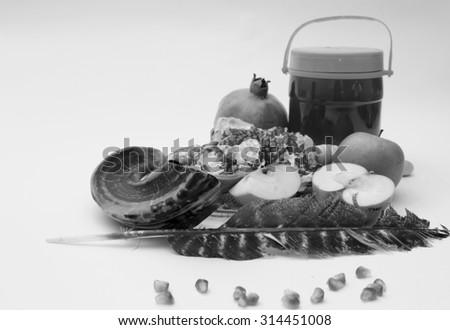 rosh hashanah (jewesh holiday) concept - shofar (horn), honey,Kiddush cup, apple and pomegranate isolated on white. traditional holiday symbols. - stock photo