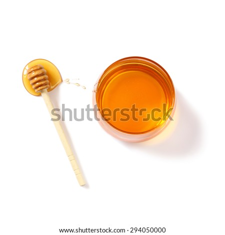 rosh hashanah (jewesh holiday) concept - top view of honey isolated on white. traditional holiday symbols.  - stock photo