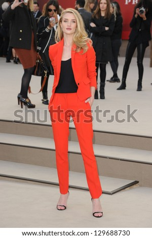 Rosie Huntington Whiteley arriving for the Burberry Prorsum catwalk show as part of London Fashion Week AW13, Kensington Gardens, London. 18/02/2013 Picture by: Steve Vas - stock photo