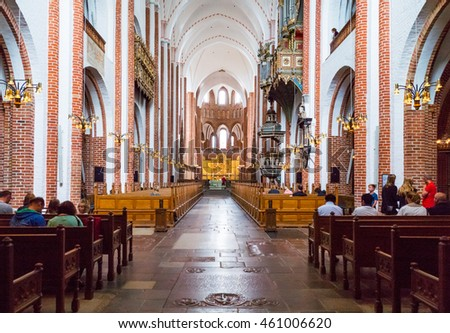 Roskilde, Denmark - July 23, 2015: People in the nave of the medieval Cathedral