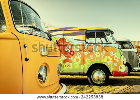 ROSMALEN, THE NETHERLANDS - JANUARY 4, 2015: Retro styled image of colorful Volkswagen Transporter type 2 vans from the seventies in Rosmalen, The Netherlands - stock photo