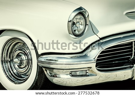 ROSMALEN, THE NETHERLANDS - MAY 10, 2015: Retro styled image of the front of a white classic car in Rosmalen, The Netherlands - stock photo