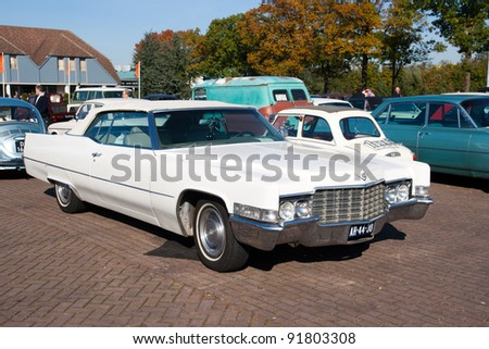 ROSMALEN, THE NETHERLANDS - OCTOBER 15: A 1969 Cadillac Deville Convertible is shown at the Rock Around the Jukebox event on October 15, 2011 in Autotron Rosmalen, Holland