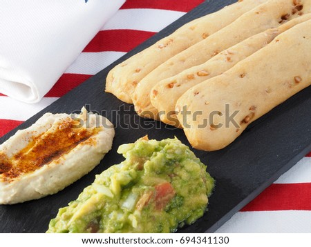 ROSQUILLETA DE CACAHUETES –  CRISPBREAD STICKS WITH PEANUTS, GUACAMOLE & HUMMUS  Valencian typical snack made with crispy bread. Made with wheat flour, oil, peanuts, salt, and yeast.