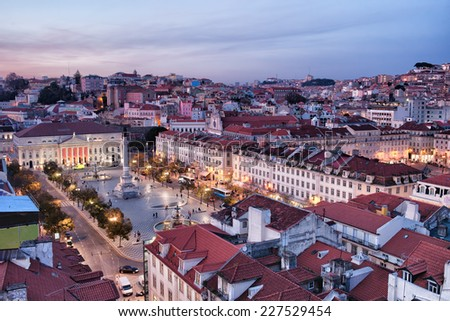 Rossio Square at dusk in the city centre of Lisbon, Portugal.